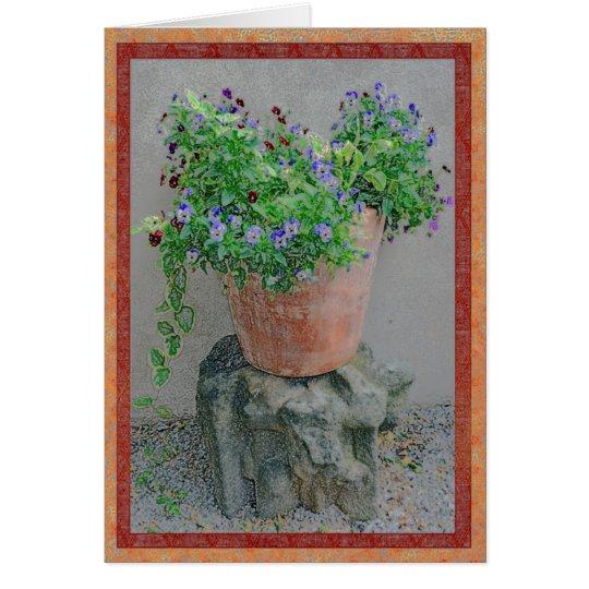 Flowers in a terra-cotta pot on rock card