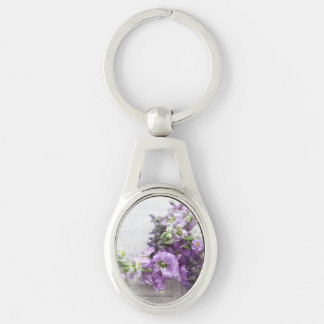 Flowers in lavender shades with music Silver-Colored oval key ring