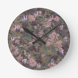Flowers, leafs, and camouflage round clock