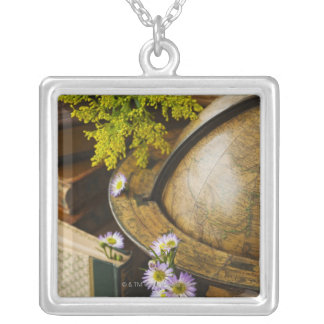 Flowers with antique globe and books silver plated necklace