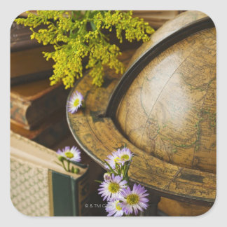 Flowers with antique globe and books square sticker