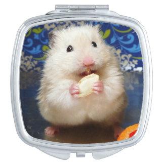 Fluffy syrian hamster Kokolinka eating a seed Compact Mirrors