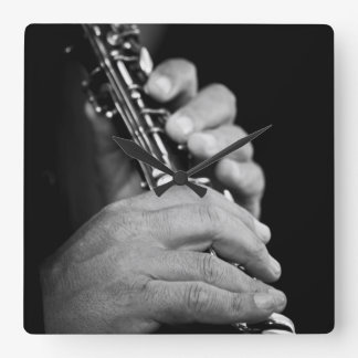 Flute being played in black and white by gypsy clocks