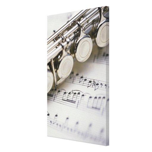 Flute on Sheet Music Canvas Prints