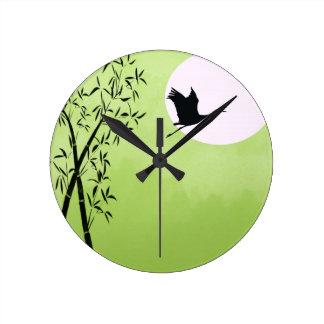 Flying crane - green round clock