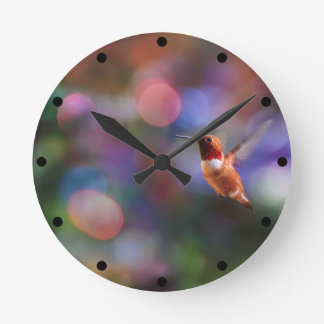Flying Hummingbird and Colorful Background Round Clock
