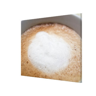 Foam on cappuccino, close-up canvas print