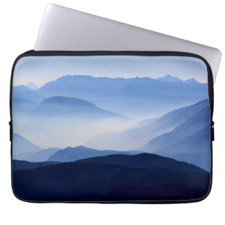 Fog covered mountain silhouettes computer sleeve