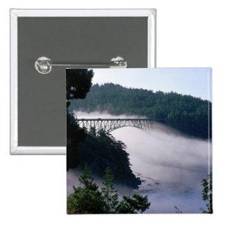 Fog drifts under the Deception Pass bridge at 15 Cm Square Badge