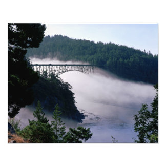 Fog drifts under the Deception Pass bridge at Photo