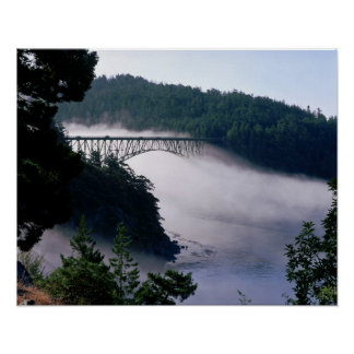 Fog drifts under the Deception Pass bridge at Poster