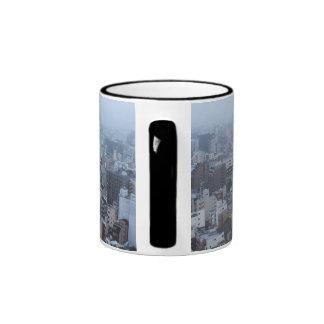 Fog over city in morning ringer mug