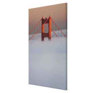 Fog rolls through the San Francisco bay covering 2 Canvas Print