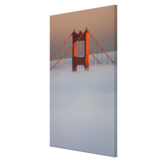 Fog rolls through the San Francisco bay covering 2 Canvas Print