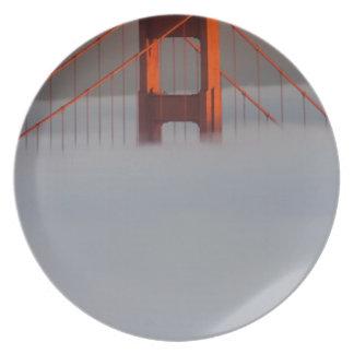 Fog rolls through the San Francisco bay covering 2 Dinner Plates
