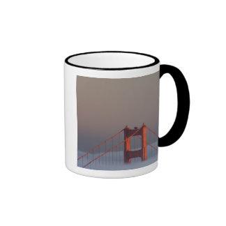 Fog rolls through the San Francisco bay covering Coffee Mug