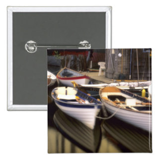 Fog surrounds four boats docked. 15 cm square badge