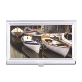 Fog surrounds four boats docked. business card holder