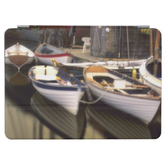 Fog surrounds four boats docked. iPad air cover
