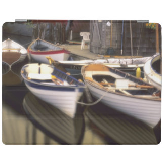 Fog surrounds four boats docked. iPad cover