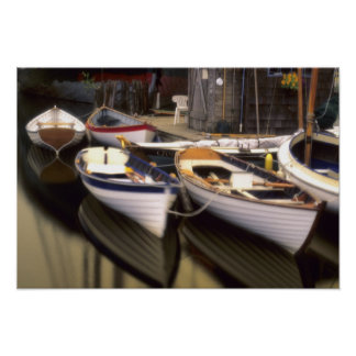 Fog surrounds four boats docked. poster