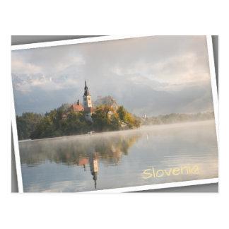 Foggy Bled Lake sunrise in Slovenia Postcard