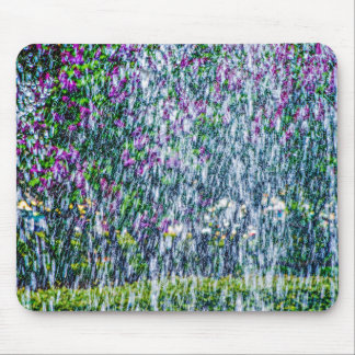 Fointain jets and lilac flowers mouse mat