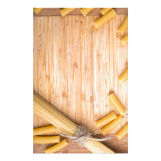 Food background with thin spaghetti and pasta stationery