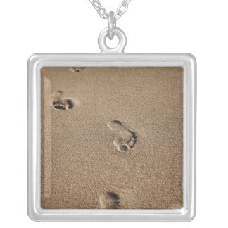 Foot steps in sand silver plated necklace