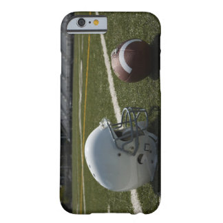 Football and football helmet on football field barely there iPhone 6 case