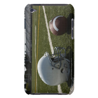 Football and football helmet on football field barely there iPod cases
