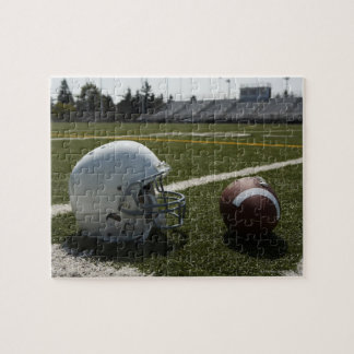 Football and football helmet on football field puzzles