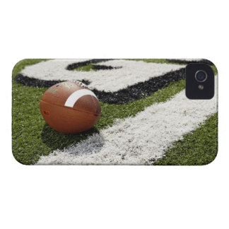 Football at goal line on football field, iPhone 4 case