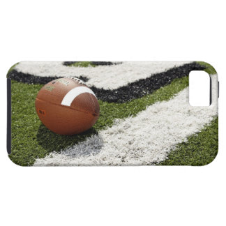 Football at goal line on football field, iPhone 5 case