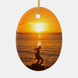 Football at sunset christmas ornament