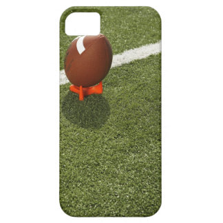 Football atop tee on football field, elevated barely there iPhone 5 case
