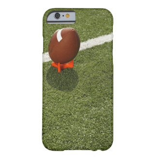 Football atop tee on football field, elevated barely there iPhone 6 case