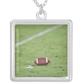 Football near yardage line. silver plated necklace