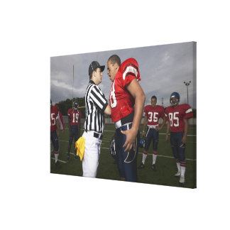 Football Player Arguing with Referee Canvas Print