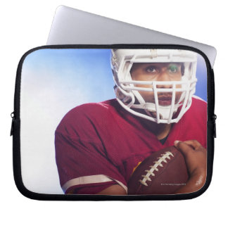 Football player carrying ball laptop sleeve