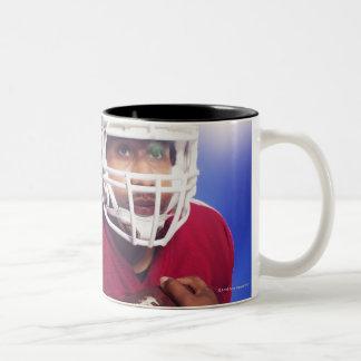 Football player carrying ball Two-Tone coffee mug