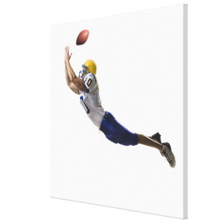 football player catching a pass canvas print