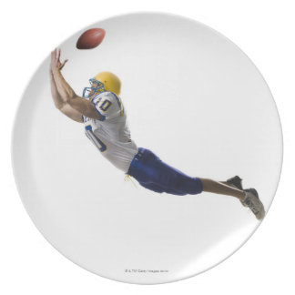 football player catching a pass plates