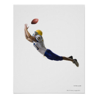 football player catching a pass posters