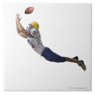 football player catching a pass tile