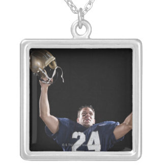Football player celebrating silver plated necklace