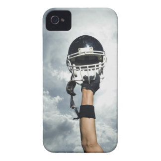 Football player holding helmet in air iPhone 4 Case-Mate case