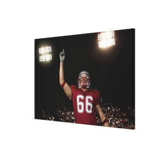 Football player holding up index finger canvas print