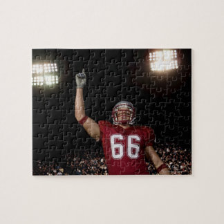 Football player holding up index finger puzzles