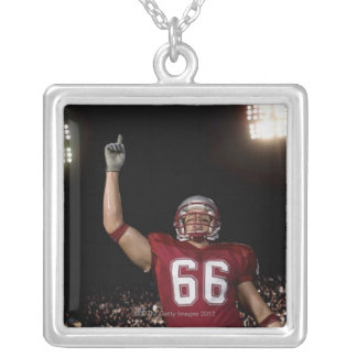 Football player holding up index finger silver plated necklace